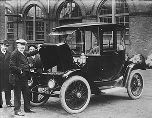 Thomas Edison inspecting batteries in his wife's 1914 Detroit Electric Model 47